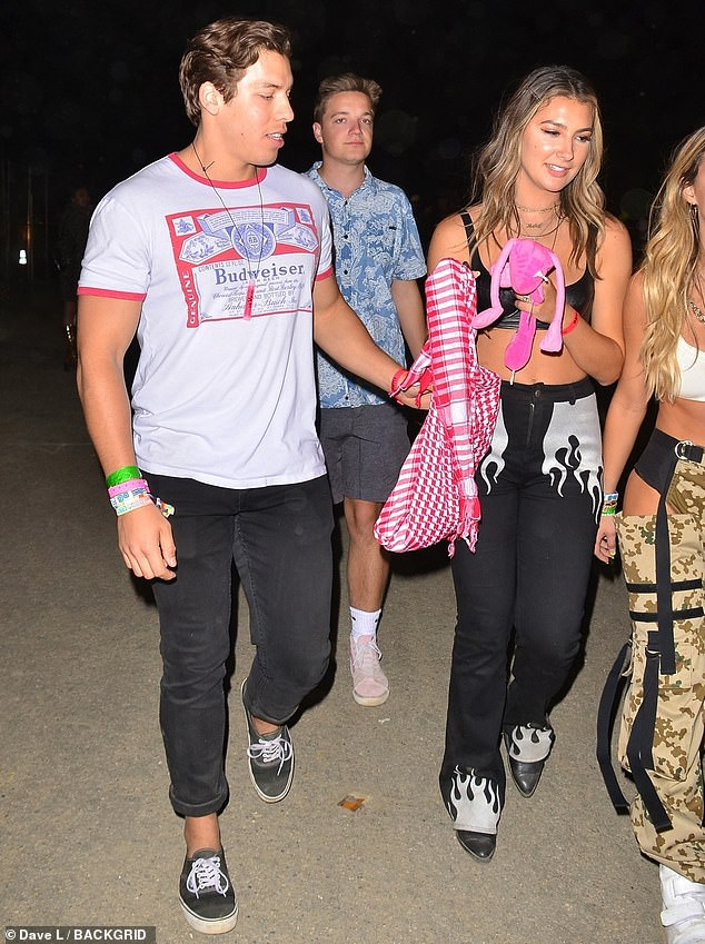 Keeping a distance: Joseph Baena and his girlfriend Nicky Dodaj were in Coachella on Saturday - while half-brother Patrick Schwarzenegger attended the festival separately