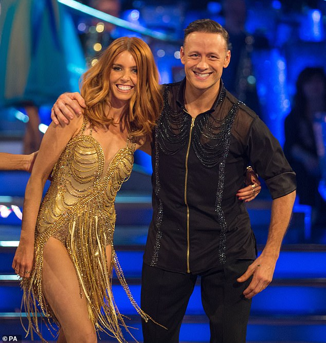 'There are two sides to every story': Stacey Dooley defended herself in a defiant tweet posted on Monday, after dumping her ex for Strictly lover Kevin (pictured)