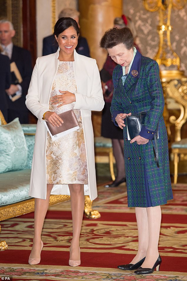 Pictured, Meghan Markle with the Princess Royal during a reception at Buckingham Palace in London to mark the fiftieth anniversary of the investiture of the Prince of Wales on 5th March