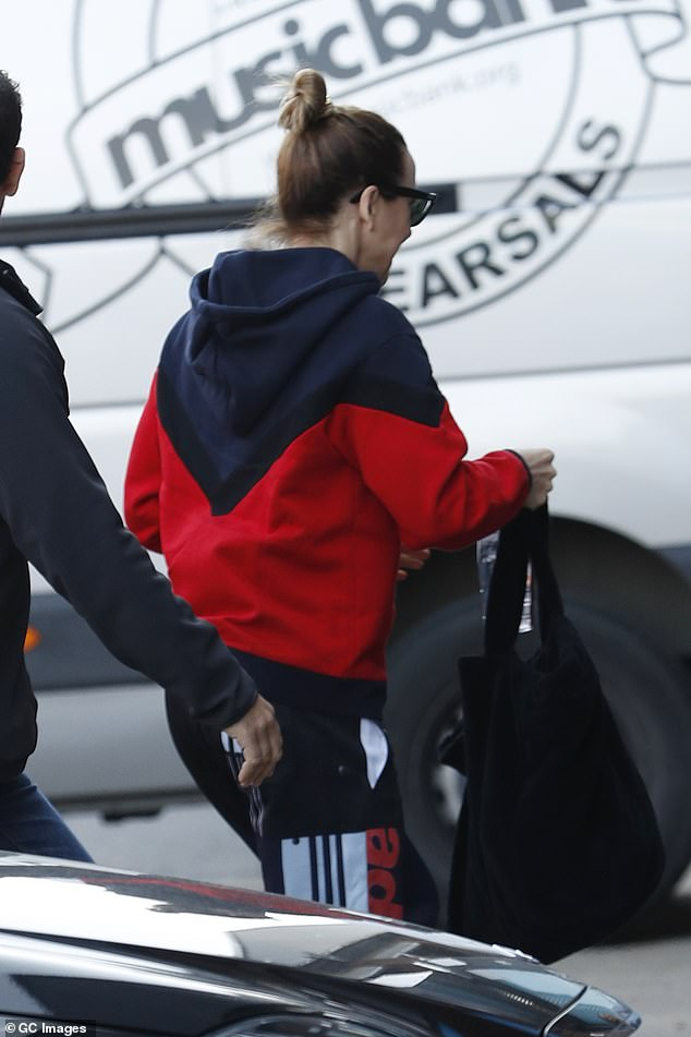 Ready for action: She wore her bright jacket with Adidas tracksuit pants of course