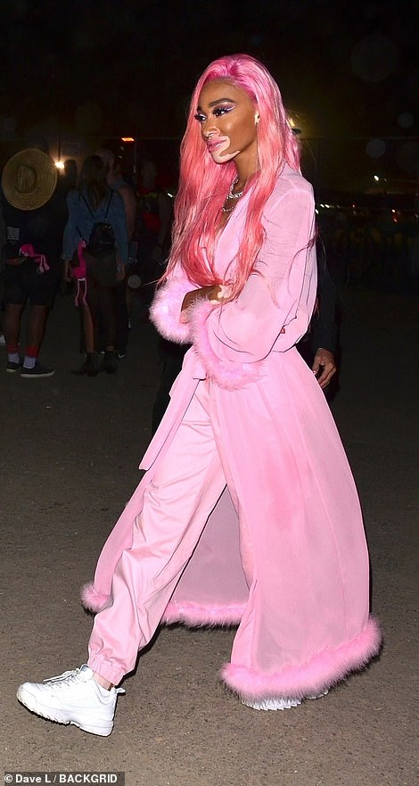 PJ style:In 2019 she looked ready for her bed in her pink trousers and furry trimmed robe