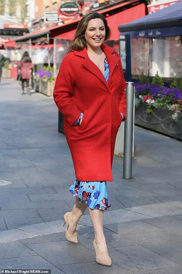 Kelly Brook was spotted leaving the Global Radio studios in London on Friday, rocking a stylish red coat as she strolled along