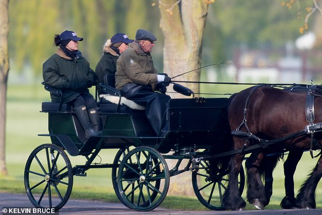 The Duke Of Edinburgh, 97, was photographed with two grooms on his carriage as he viewed preparations for the upcoming Royal Windsor Horse Show