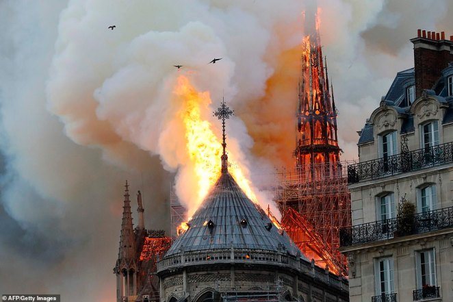 The fire spread rapidly across the roof-line of the cathedral leaving one of the spires and another section of the roof engulfed in flames