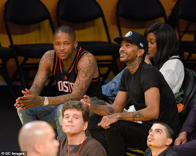 The shooting reports come two weeks following the death of beloved LA rapper Nipsey Hussle, who was close friends with YG. The two pictured above at a Lakers game in 2016