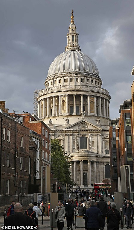 St Paul's Cathedral (pictured now) caught fire, with the lead roof melting and pouring into the street 'like a river' as the building collapsed