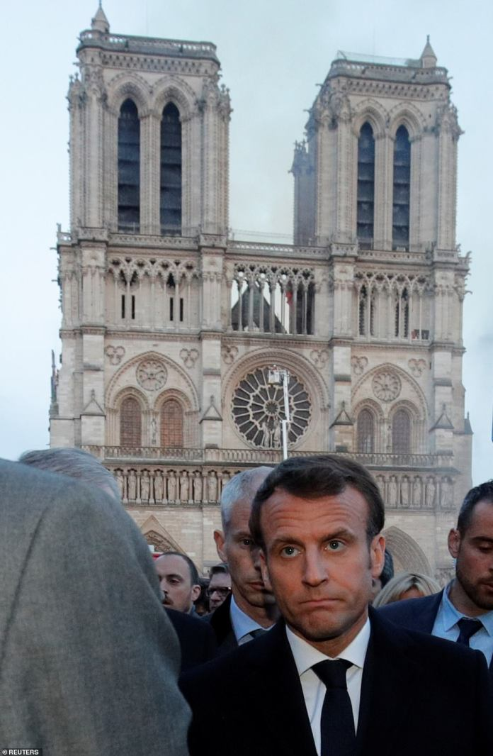 A visibly upset Emmanual Macron walking near the Notre Dame Cathedral as it burns this evening. The French President postponed an important address to the nation that was to lay out his responses to the yellow vest crisis because of the massive fire