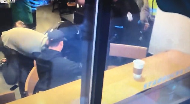 Sutton was taken down by a by-stander in Starbucks who performed a citizen's arrest before police arrived and took him into custody