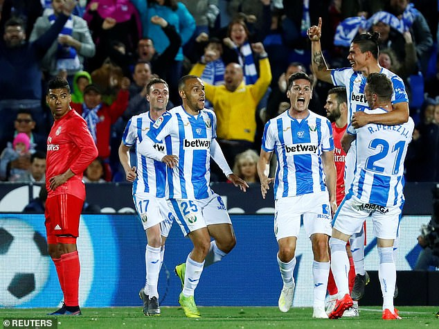 Jonathan Silva is held aloft by his Leganes team-mates after scoring the opening goal