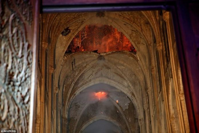 Pictures from inside the centuries old church show the stone-built roof of the structure partially caved in after the huge blaze