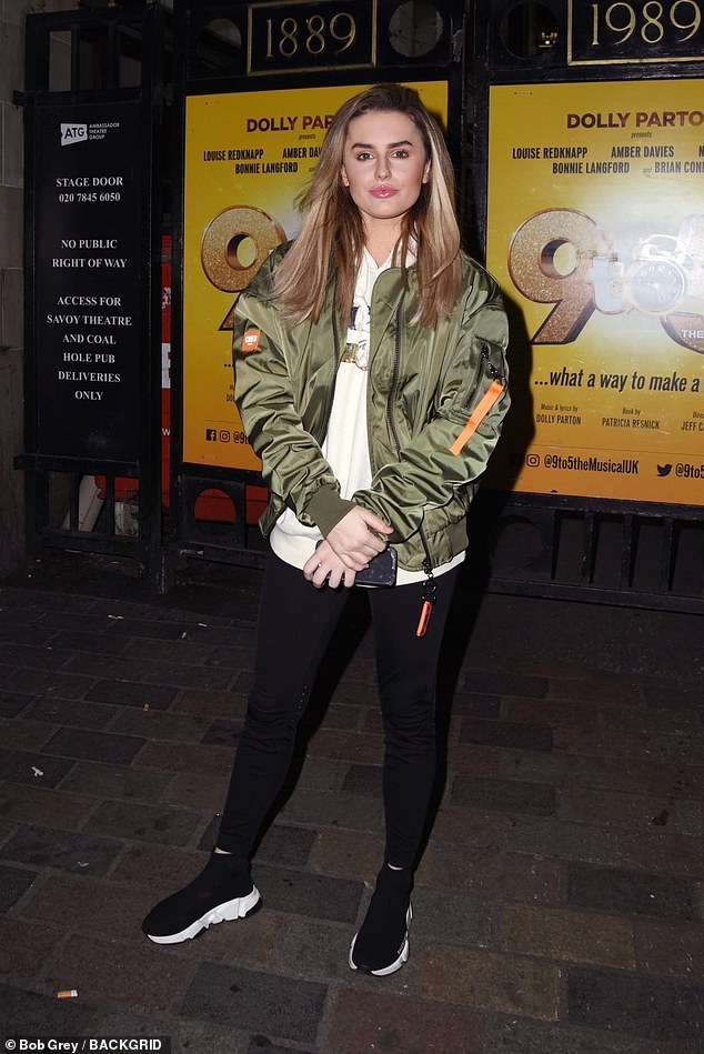 Stylish: Amber Davies was also spotted outside the theater in a sporty ensemble, a Gucci hoodie with a khaki green bomber jacket, black leggings and Balenciaga trainers