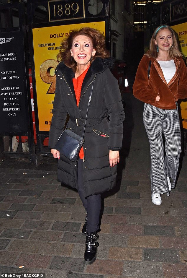 Keeping warm: Co-star Bonnie Langford kept warm in a long puffer coat and heeled boots