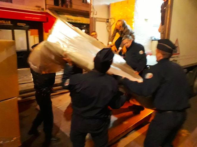 Emergency responders worked with city staff to manhandle priceless relics away from the fire