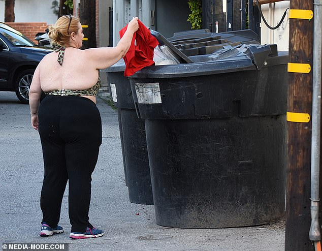 Good riddance! She then went downstairs and stripped off the shirt, which had presumably got stained, and hauled it into the garbage