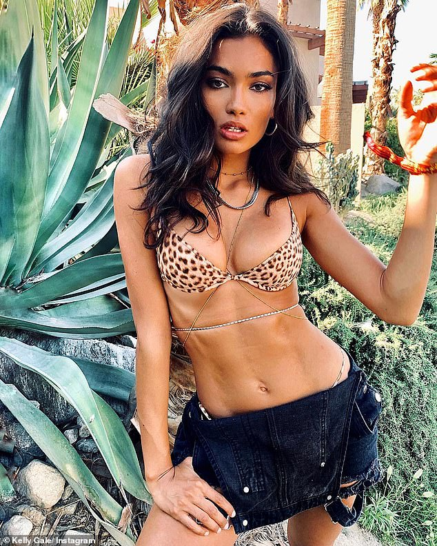 Wild thing! Victoria's Secret model Kelly Gale showed off her ripped abs and extreme cleavage in a leopard print bra at Coachella on Sunday in Indio, California