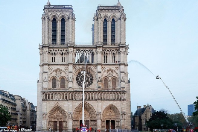 Hundreds of firefighters battled to stop the fire wreaking complete destruction of the treasured facade (pictured) after flames torched the roof, sending its spire crashing to the ground before crowds of Parisians