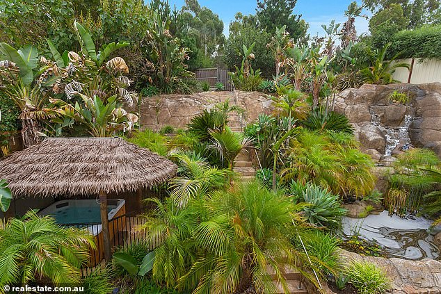 Amazing Home Tropical Backyard Complete With A Waterfall And A Home Interior And Landscaping Staixmapetitesourisinfo