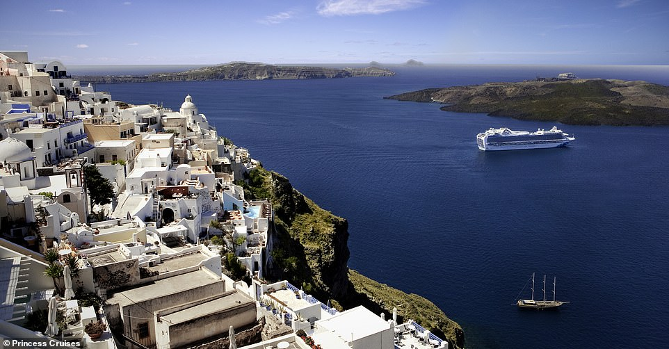 The picturesque white-washed buildings of Santorini gaze down on the Emerald Princess ship as it sails into the submerged caldera. The vessel, which carries 3,080 guests, embarks on regular Mediterranean itineraries. Santorini, which has a population of 25,000, has grown in popularity to the point where Mayor Nikolos Zorzos has limited the number of cruise ship passengers that can disembark to 8,000 a day from a peak of 18,000 in 2016 because of over-crowding