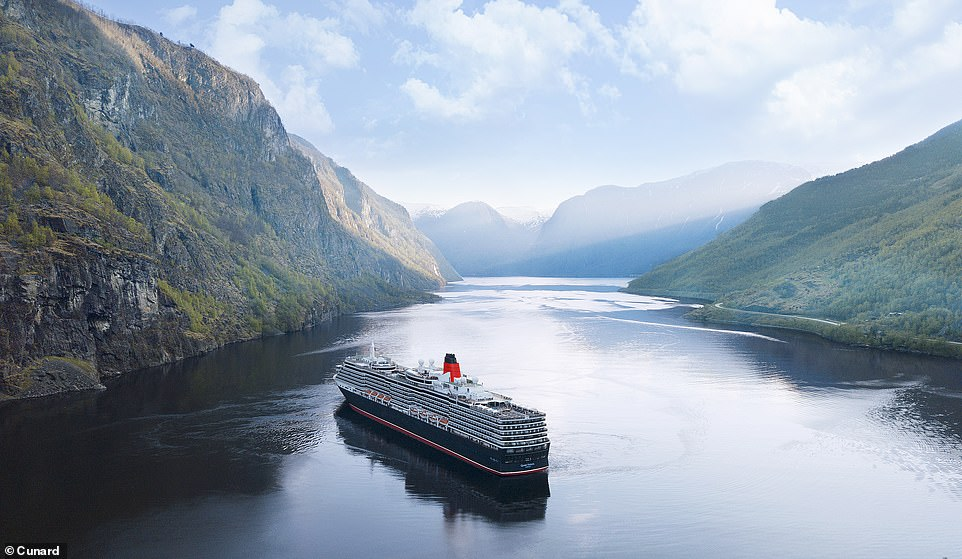 Cunard's Queen Victoria is described as a ship that offers a 'unique atmosphere' and 'encourages a sense of escapism'. It can hold up to2,061 passengers, 981 staff members and it measures964.5 feet in length. Above, the grand ship is seen sailing down Aurlandsfjord, where the small tourist village of Flaamis located
