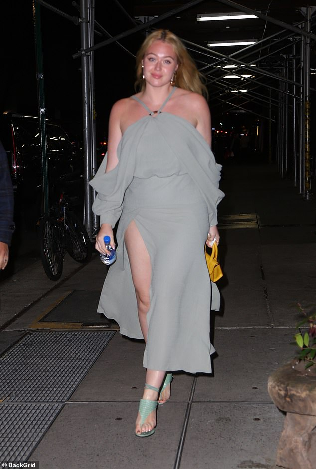 Chic: Iskra accessorised with a pair of summery green sandals, with a small kitten heel, and added a pop of colour with a bright yellow bag