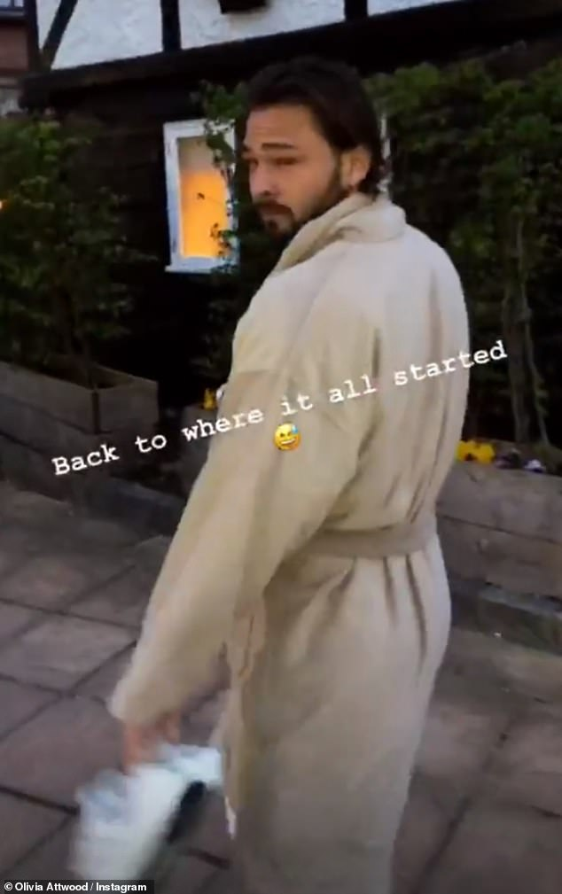 Real love:Olivia filmed her beau Bradley clad in his dressing gown and carrying his trainers when they made the most of their romantic night away