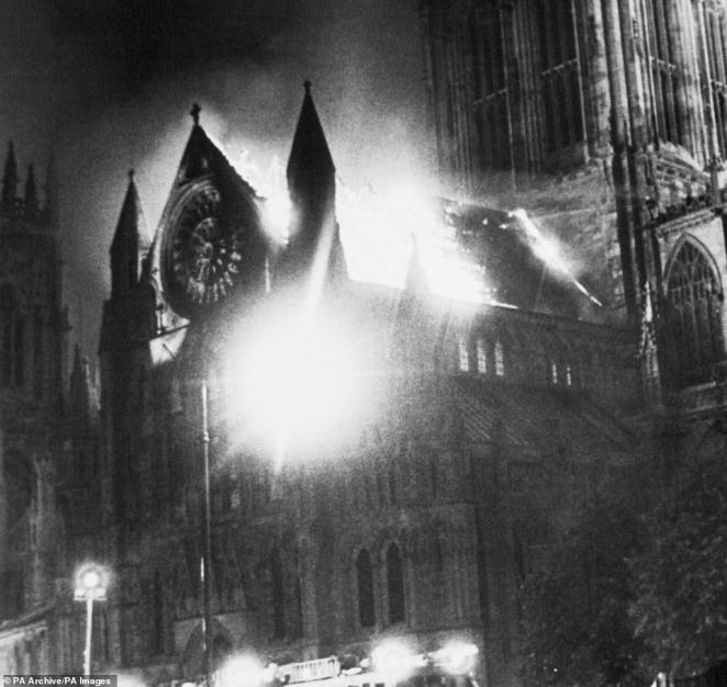 The south transept of York Minster at the height of the blaze. Like Notre Dame, the English cathedralas built from ancient stone and timber, which made tackling the blaze even more difficult for fire crews at the time