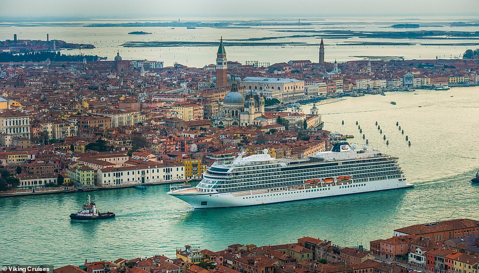 The historic city of Venice looks dinky alongside theViking Sea ship as it is guided through the narrow waterways. More than one million cruise passengers flood the pedestrian metropolis each year, with some locals angered by the influx of tourists.Earlier this year councillors overwhelmingly endorsed an entry fee at a meeting, saying visitors would have to pay three euros (£2.57) each from May to visit