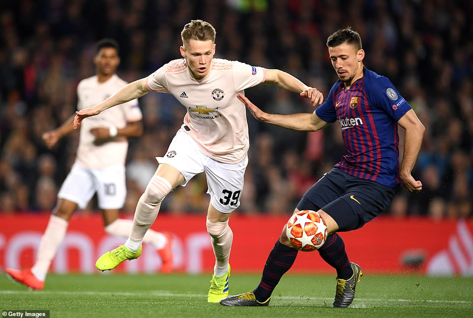 Scott McTominay (left) tries to dispossess Barcelona centre backClement Lenglet (right) during their clash at the Nou Camp