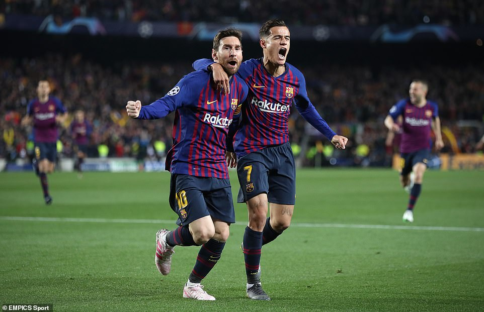 Messi (left) celebrates with Philippe Coutinho (right) after the Argentine gave Barcelona an early lead on Tuesday night