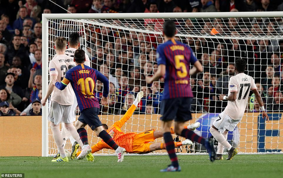 Messi watches his shot nestle into the inside side netting of De Gea's goal with the Spaniard unable to reach the shot