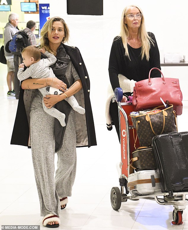 Airport style: Accompanied by her mother Yvonee Tozzi, Cheyenne dressed casually in trackpants and slides but added a touch of glamour by draping a blazer over her shoulders