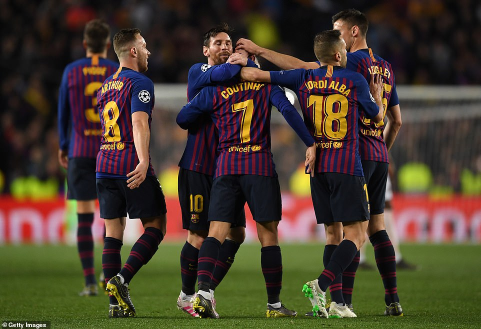 Coutinho is congratulated by his Barcelona team-mates after scoring their third goal of the night and fourth of the tie