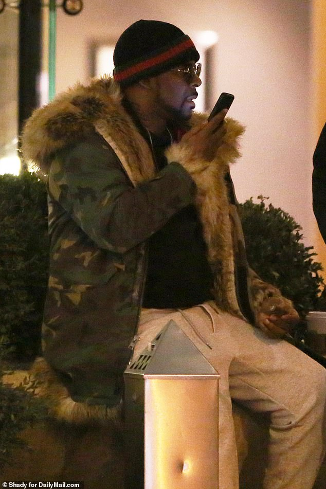 R. Kelly appeared to be on a very serious phone call Tuesday evening, hours after it was revealed that the singer could end up behind bars again after missing child support payments