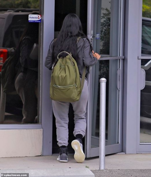 She's got this! Kim disappeared into an office building after arriving solo