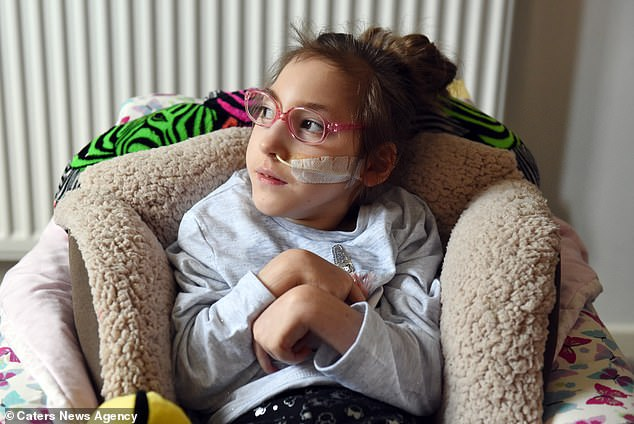 Ms King said they have seen Lily's personality grow and she is even able to go to school. Pictured: Lily at home recently