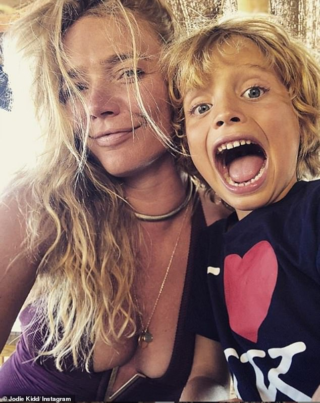 Mum's the word: Jodie Kidd has admitted that the pressures placed on mothers to juggle work and family life are unrealistic and 'absolute rubbish' (pictured with her son Indio, seven)