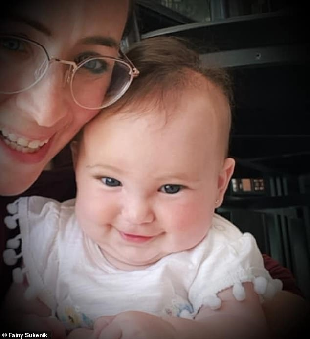 A few days later, the red spots that are the hallmark of measles appeared on Shira's body. She was too young to be vaccinated because doctors don't administer the shot until patients are at least one year old. Pictured: Shria with her mother, Fainy Sukenik