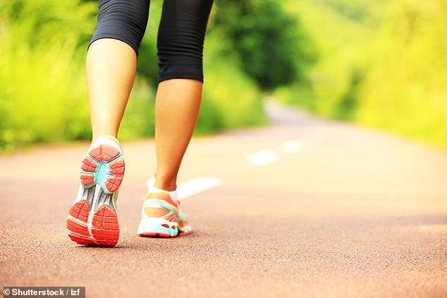 Even exercise as light as walking, as long as you do it regularly, could be enough to boost your brain power and slow down the mind's ageing process, experts say (stock image)