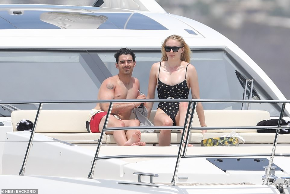 Time out: The Jonas Brothers singer and the Game of Thrones star, who are set to have a summer wedding, appeared to be completely care-free as they relaxed in the sunshine