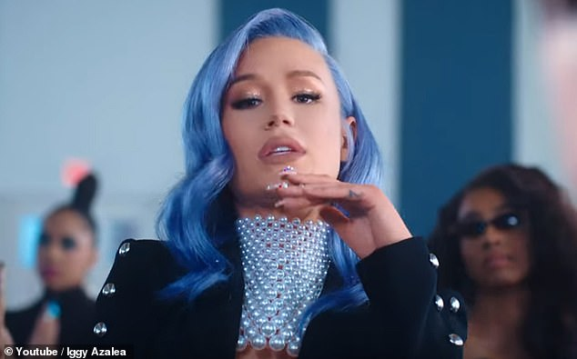 Her decision: Iggy defended her decision to have a nose job, in an interview with Elle Canada in 2016. Pictured in the video for track Sally Walker