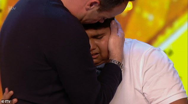 Sweet: Ant gave Akshat a hug as he broke down in tears on stage after getting through