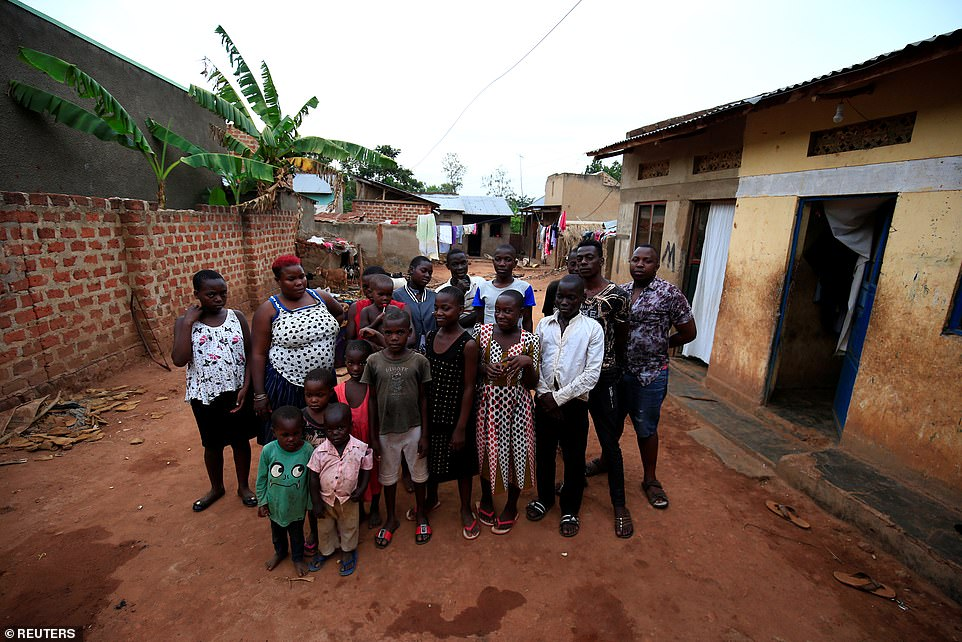 Mariam Nabatanzi, 39, (second left) a mother of 38 children, takes a family portrait with some of her children at their home in Kasawo village, Mukono district, east of Kampala, Uganda