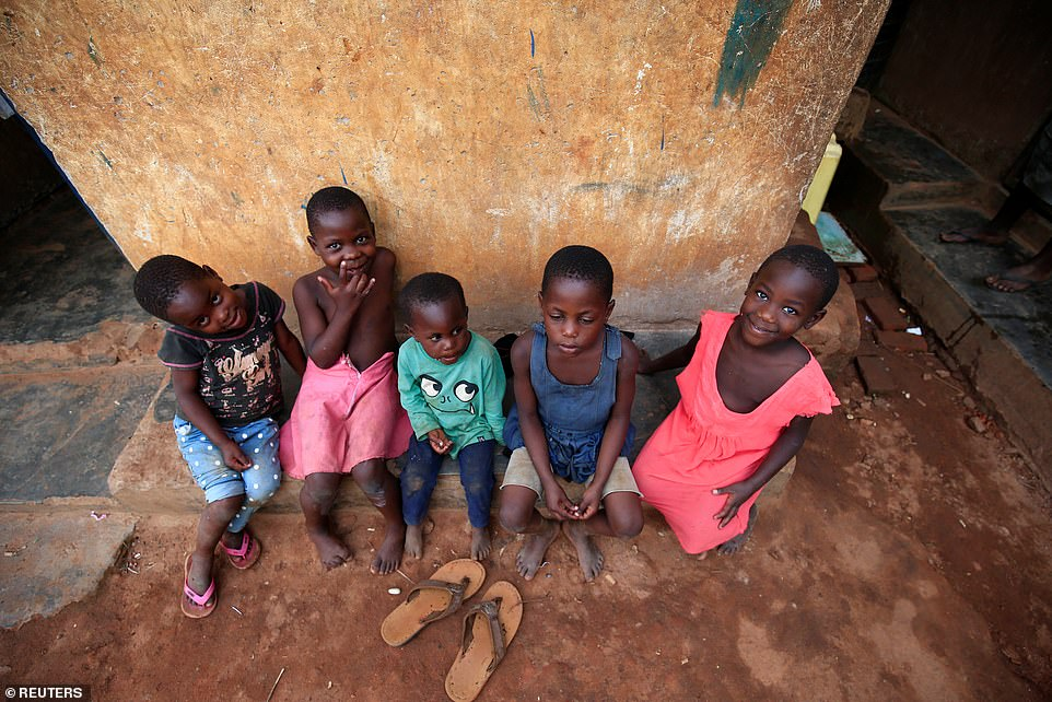 Some of her children rest on the veranda at their home in Kasawo village, Mukono district, east of Kampala, Uganda