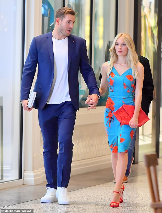 Pretty pair! Colton Underwood and Cassie Randolph looked like they belonged on the cover of a magazine as they strolled around a mall in Los Angeles on Wednesday night