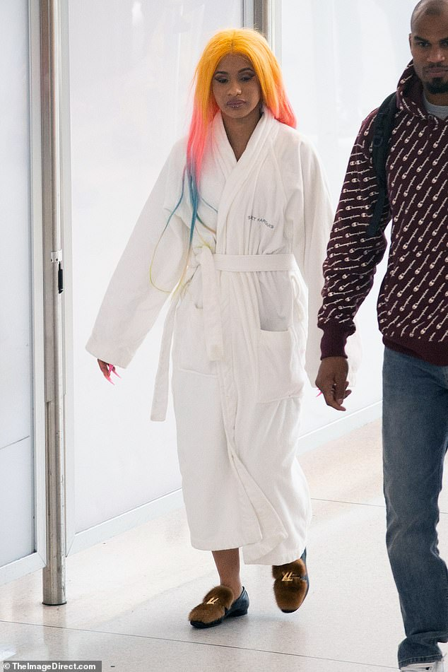 Up, up and away! The 26-year-old musician covered up in a robe and slippers as she trekked through the terminal before lamenting on Instagram that she's about to endure an arduous '13 hour flight'