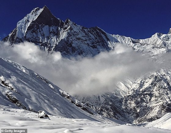 Annapurna Range (pictured above) where Mr Chin became separated from his group