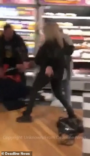 After the attacker falls on the floor, the other woman kicks her before being dragged away after also falling to the ground. This gives her opponent (middle) the chance to try and attack again