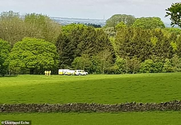 Pictured: Police cordon off an area of woodland where the missing teenager's body was found