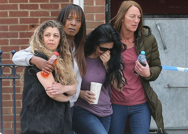 The sister of Mary Jane Mustafa, second from the right, visited the scene in east London where two women's bodies were found, before she was identified