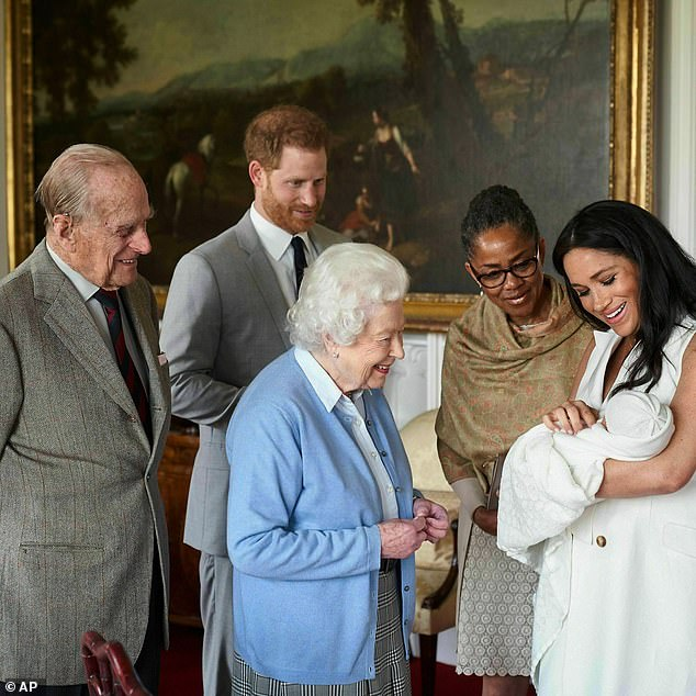 She added: 'Tom was an awful father. What makes him think he'd be a great ­grandfather to Archie?' Pictured: Meghan and Prince Harry with Meghan's mother Doria as they introduce their newborn to the Queen and Prince Philip